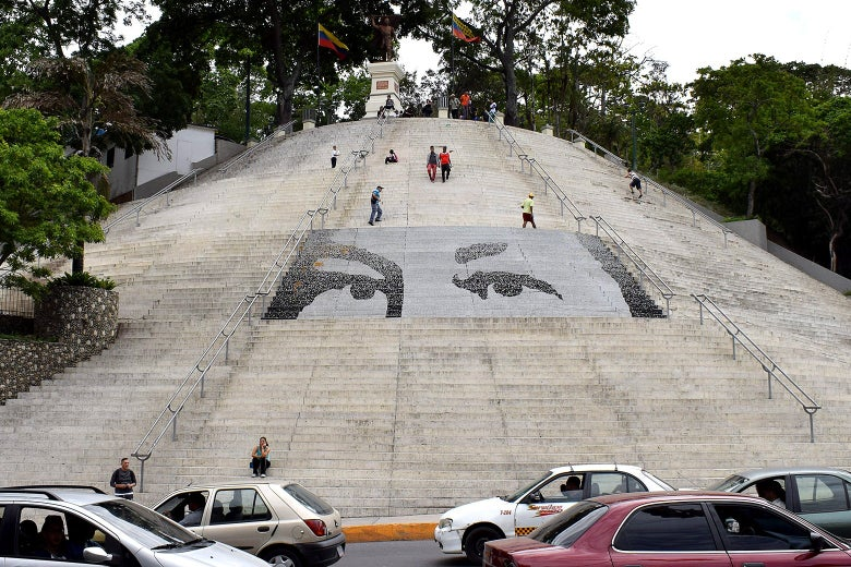 Hugo Chávez's eyes superimposed on a staircase in Caracas.