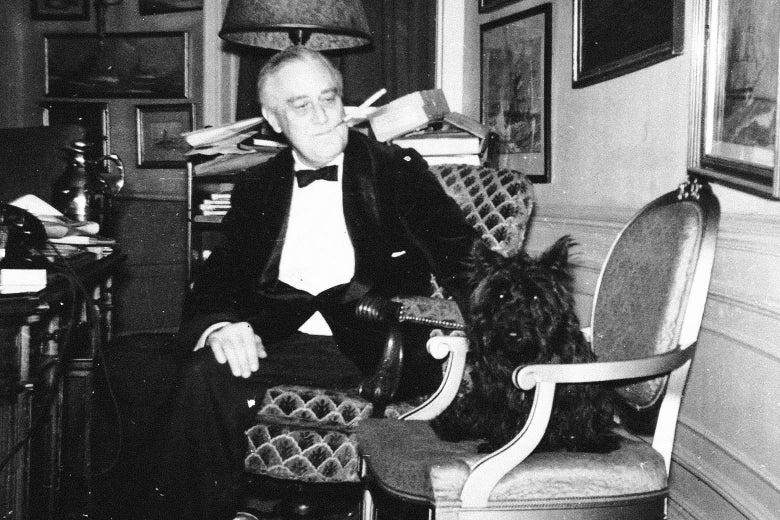 Franklin Delano Roosevelt and Fala, sitting in the White house.