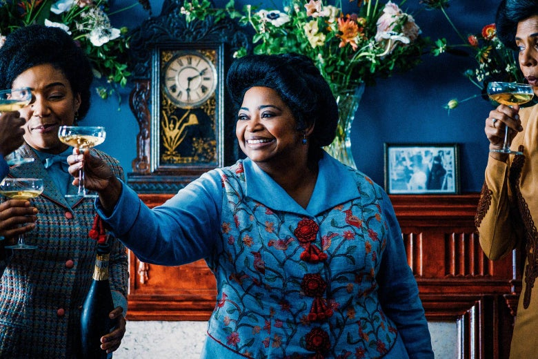 Octavia Spencer raises a cocktail to cheer with a group of women.
