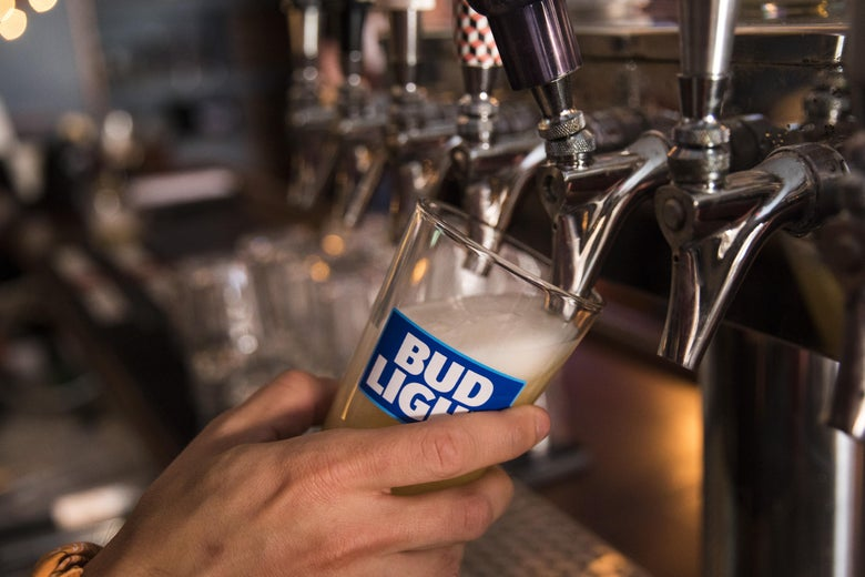 A bartender pours Bud Light from a tap.