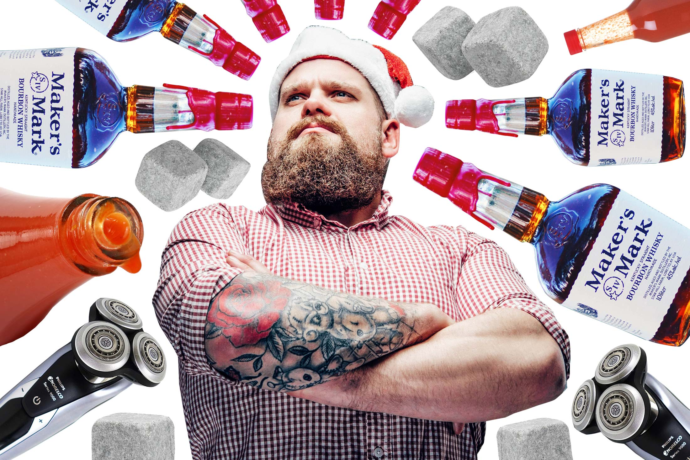 A man wearing a plaid shirt and Santa Claus hat surrounded by a mandala of whiskey hot sauce and beard trimming appliances.