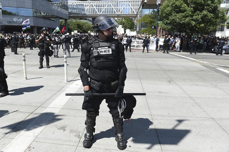 A Portland Police officer blocks the crossing of Naito Parkway during the Alt Right Rally at Tom McCall Waterfront Park on August 4, 2018 in Portland, Oregon.