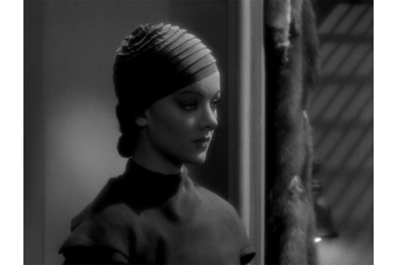 Myrna Loy in exaggerated makeup, in a still from Thirteen Women.