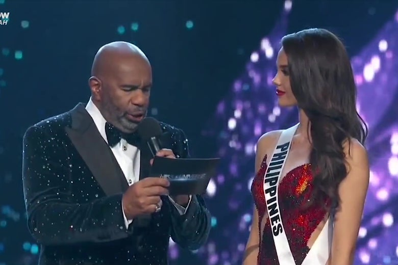 Steve Harvey asks Catriona Gray a question during the Miss Universe pageant.