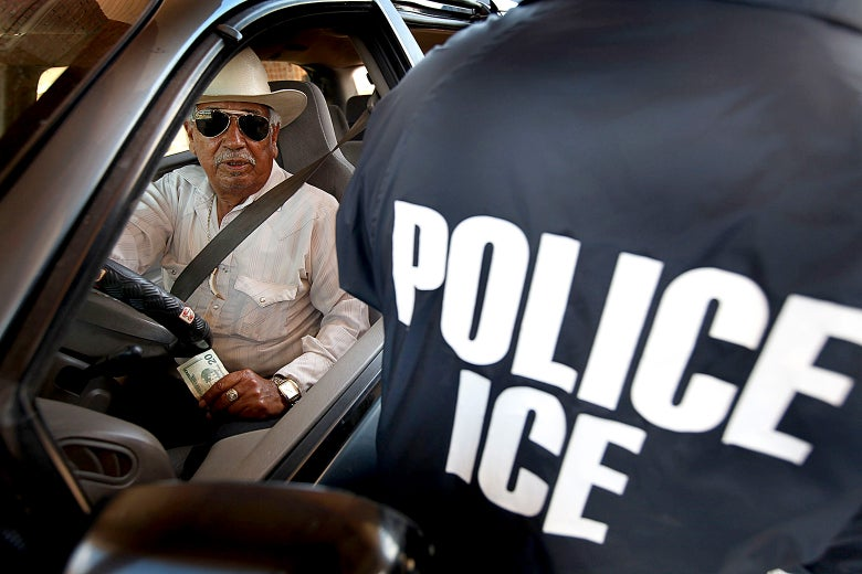 A special agent from ICE searches a vehicle heading into Mexico at the Hidalgo border crossing on in Hidalgo, Texas.