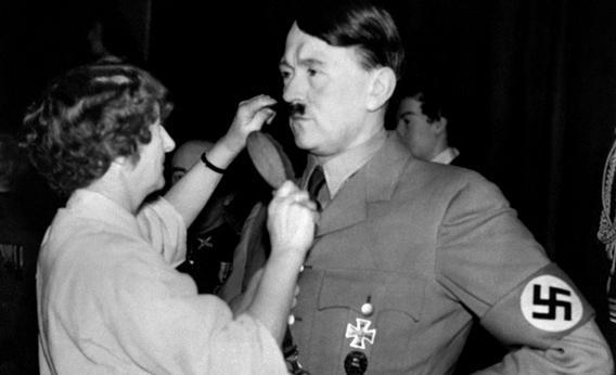 A picture released in 1938 shows the wax figure of German Nazi Chancellor Adolf Hitler having his moustache combed by a hairdresser at Madame Tussauds Wax museum in London.