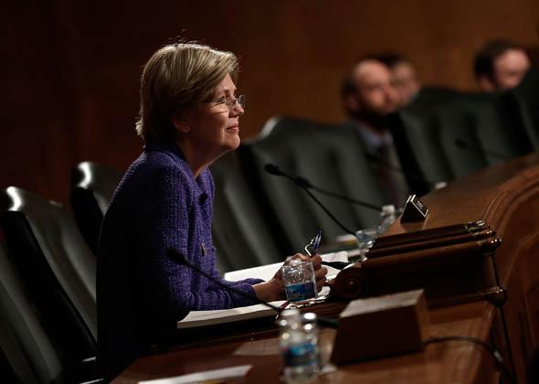 Sen. Elizabeth Warren (D-MA) listens as Consumer Financial Protection Bureau Director Richard Cordray testifies before the Senate Banking, Housing and Urban Affairs Committee November 12, 2013 in Washington, DC.