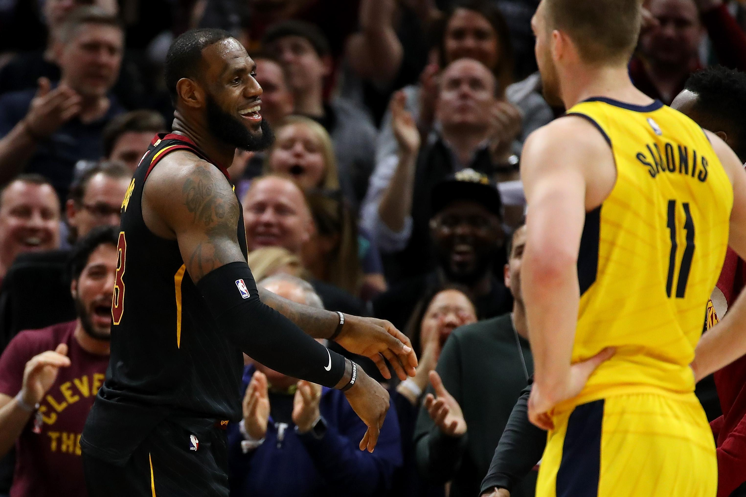 CLEVELAND, OH - APRIL 29: LeBron James #23 of the Cleveland Cavaliers react after a first half basket next to Domantas Sabonis #11 of the Indiana Pacers in Game Seven of the Eastern Conference Quarterfinals during the 2018 NBA Playoffs at Quicken Loans Arena on April 29, 2018 in Cleveland, Ohio. NOTE TO USER: User expressly acknowledges and agrees that, by downloading and or using this photograph, User is consenting to the terms and conditions of the Getty Images License Agreement. (Photo by Gregory Shamus/Getty Images)