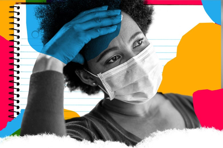 A woman with a surgical mask on holds her head in her hand.