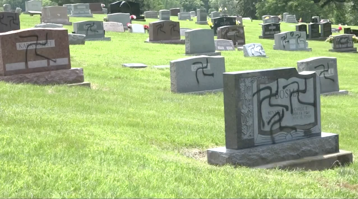 A screenshot shows headstones at the Sunset Hill Cemetery in Glen Carbon, Illinois on May 26, 2018.