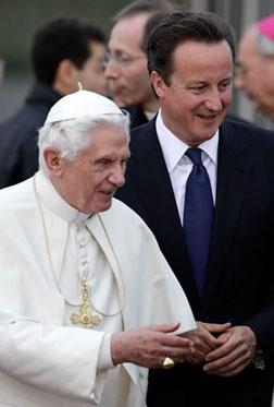 ope Benedict XVI introduces British Prime Minister David Cameron to members of the clergy. Click image to expand.