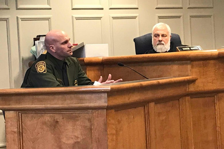 Customs and Border Protection Officer Mark Qualter testifies in Plymouth District Court as Judge Thomas Rappa looks on.  Photo by Mark Joseph Stern.