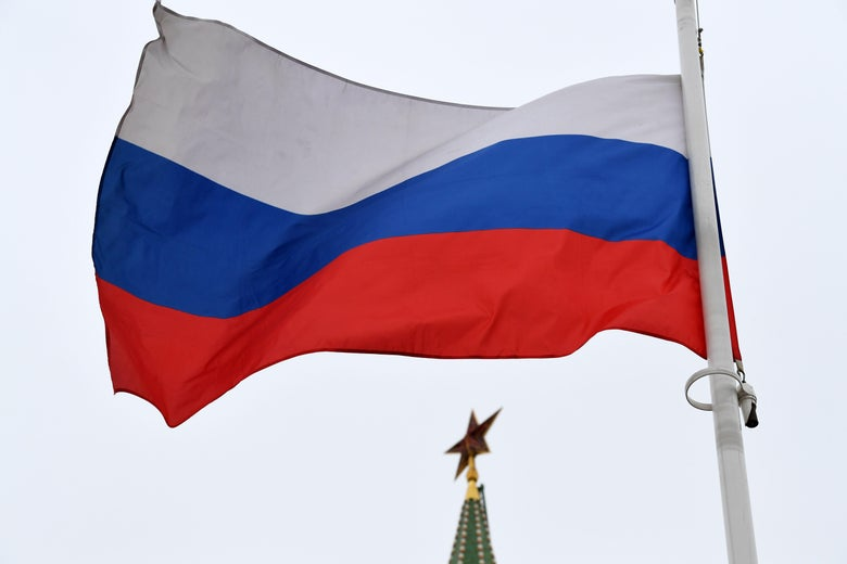 A Russian flag flies in front of a ruby star atop one of the Kremlin's towers in downtown Moscow on March 13, 2018. Russia will hold presidential elections on March 18, 2018. / AFP PHOTO / Kirill KUDRYAVTSEV        (Photo credit should read KIRILL KUDRYAVTSEV/AFP/Getty Images)