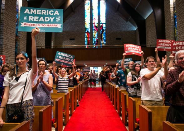 A crowd stands to applaud at the Central Presbyterian Church in celebration of Friday's same-sex marriage announcement on June 26, 2015, in Austin, Texas.