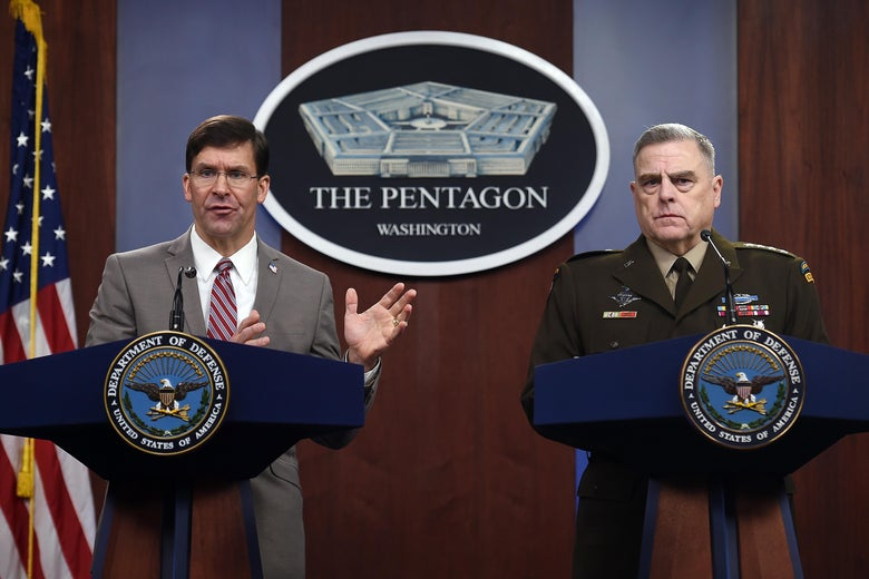 Esper and Milley stand at podiums at the Pentagon.