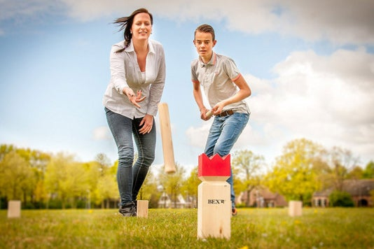 Players playing the Bex Sports Kubb Game Original Red King.