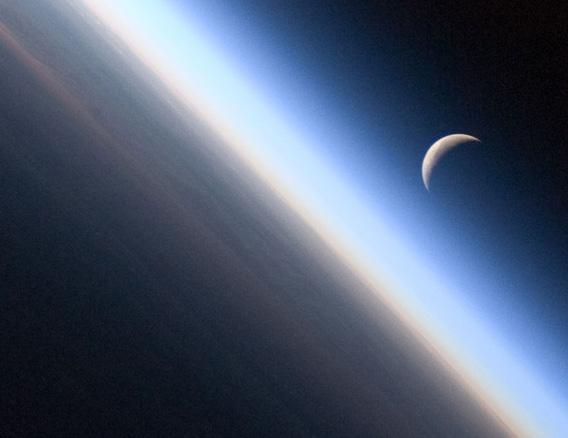 The old Moon, rising over the Earth's morninglit edge.