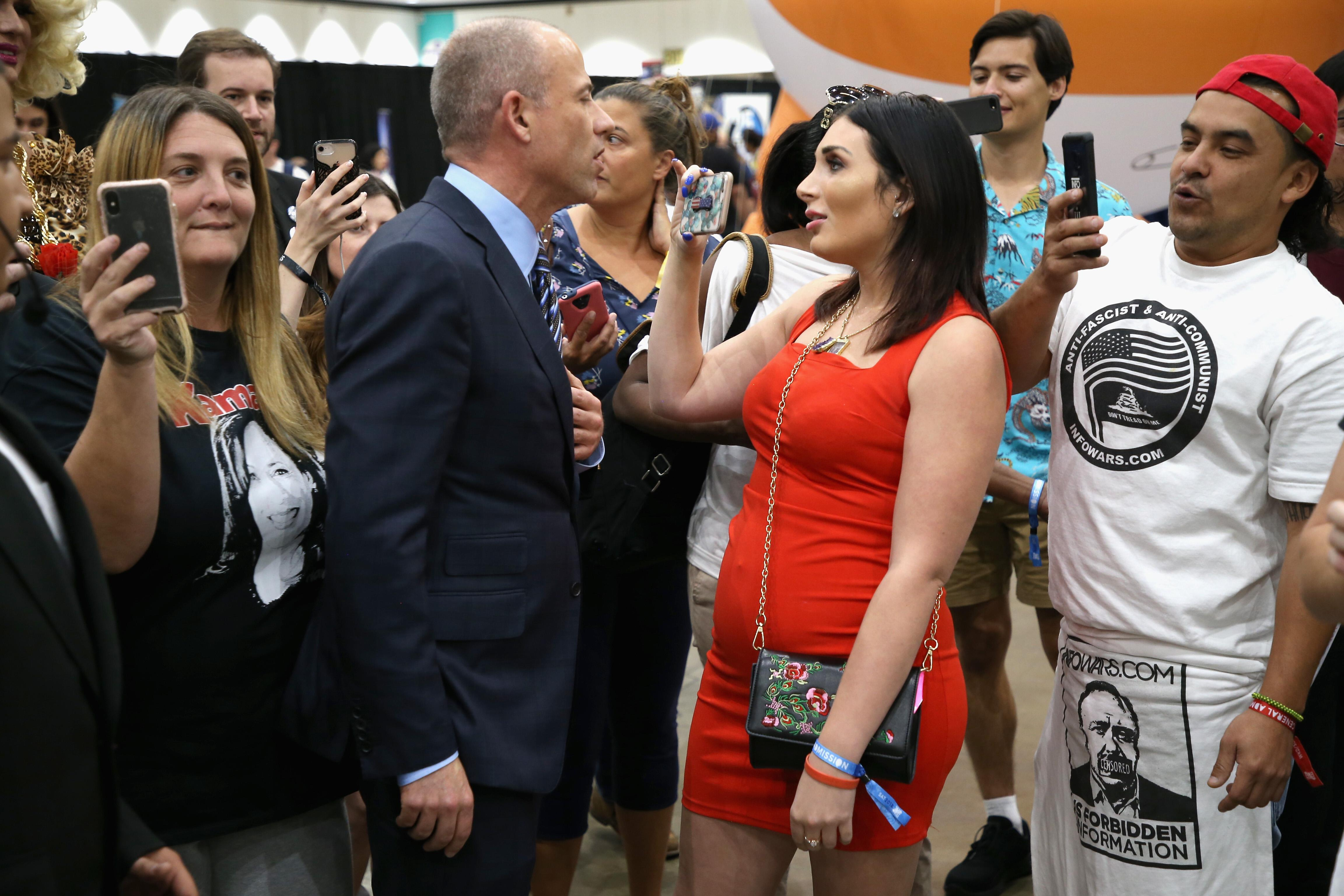 LOS ANGELES, CA - OCTOBER 20:  Michael Avenatti (L) and Laura Loomer attend Politicon 2018 at Los Angeles Convention Center on October 20, 2018 in Los Angeles, California.  (Photo by Phillip Faraone/Getty Images for Politicon)