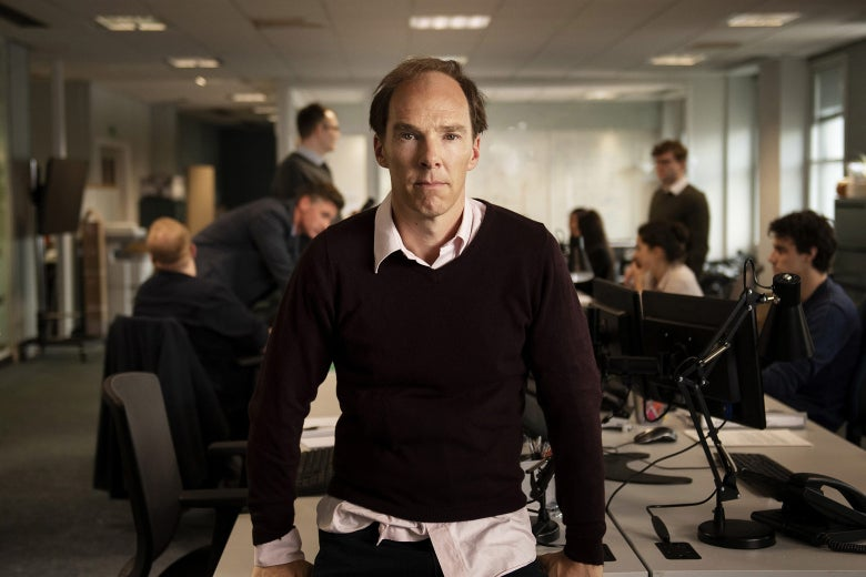Benedict Cumberbatch, looking balding and disheveled, in an office.