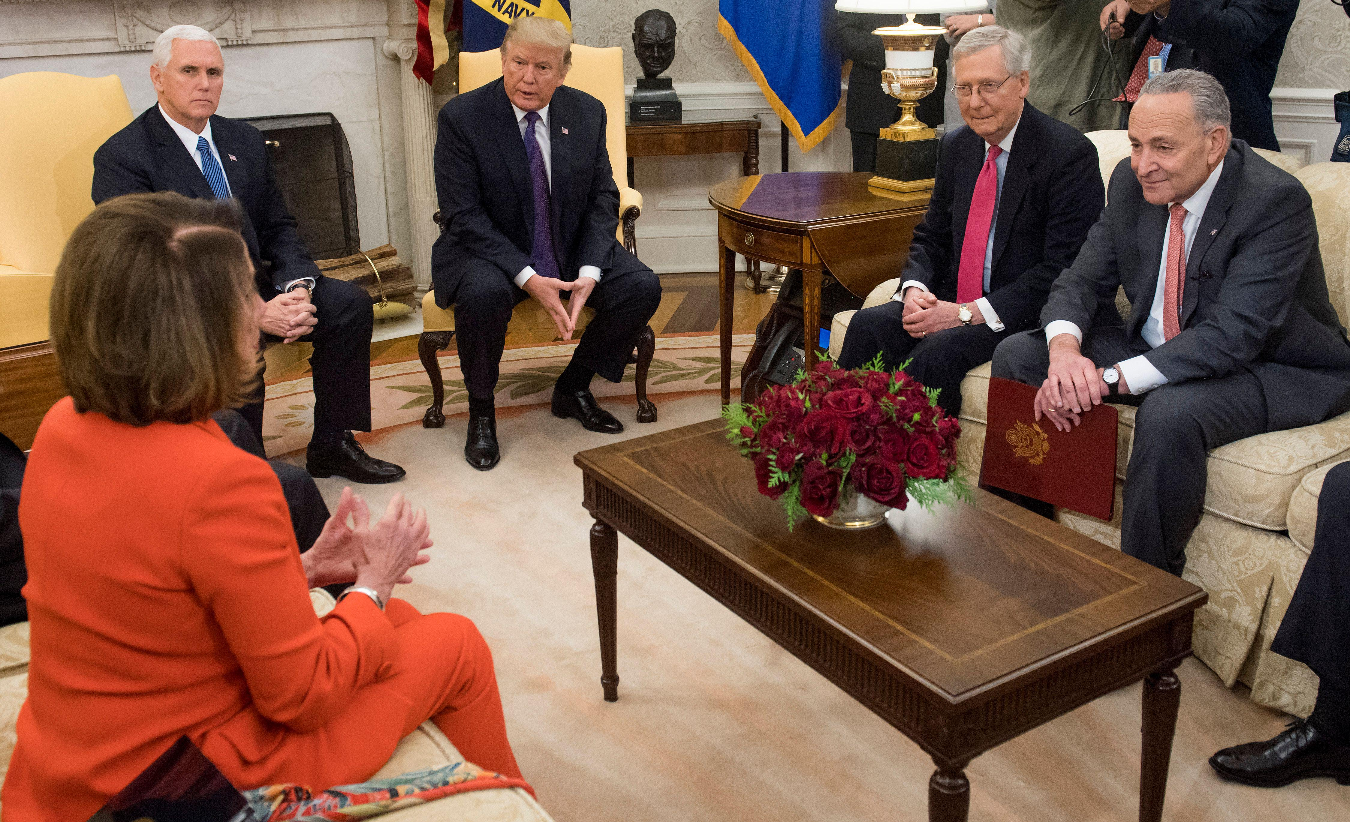 President Donald Trump meets with Congressional leadership including Senate Majority Leader Mitch McConnell (2nd R), Republican of Kentucky, Senate Minority Leader Chuck Schumer (R), Democrat of New York, and House Democratic Leader Nancy Pelosi (L), Democrat of California, in the Oval Office at the White House in Washington, DC, December 7, 2017. / AFP PHOTO / SAUL LOEB        (Photo credit should read SAUL LOEB/AFP/Getty Images)