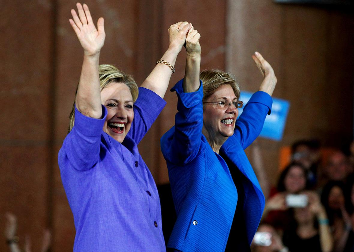 Democratic Presidential candidate Hillary Clinton and U.S. Sen Elizabeth Warren wave to the crowd before a campaign rally at the Cincinnati Museum Center at Union Terminal June 27, 2016 in Cincinnati, Ohio.