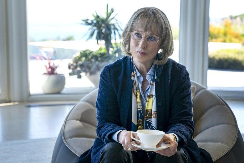 Meryl Streep as Mary Louise, holding a tea cup and saucer.
