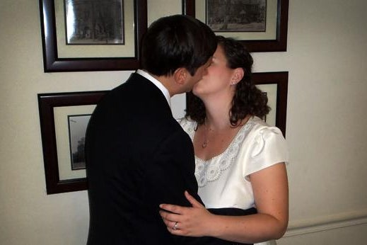 Newlyweds Chris Coccaro and Torie Bosch kiss on the day of their elopement. Photo by Gerald Williams.