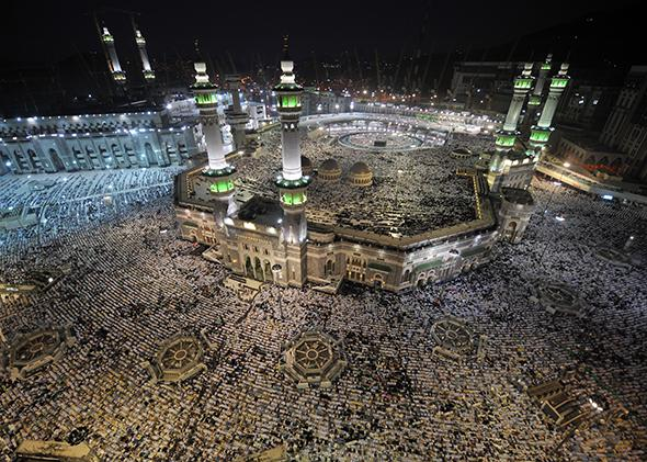 Pilgrims participating in the Hajj perform evening prayers in Mecca's Grand Mosque on Oct. 8, 2013.