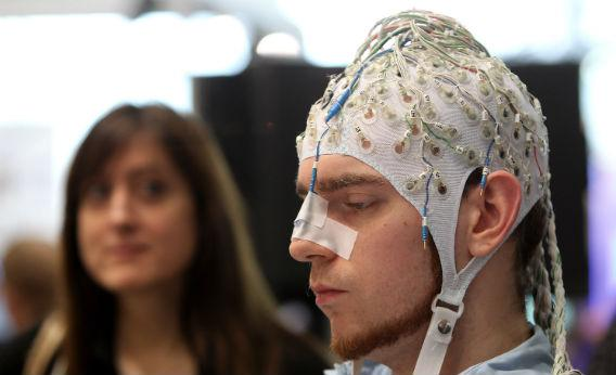 Man being monitored by EEG