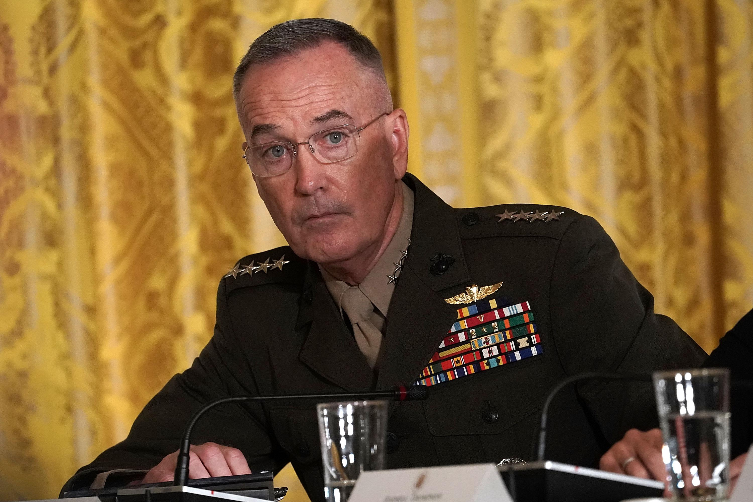 Gen. Joseph Dunford listens during a meeting of the National Space Council at the East Room of the White House.