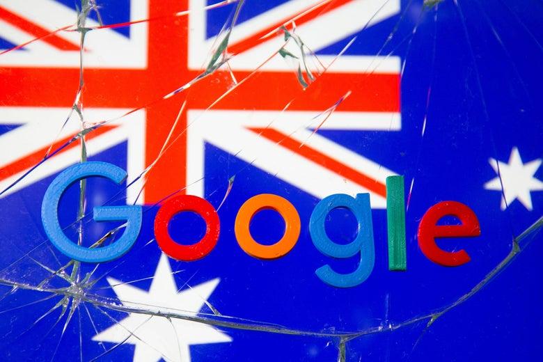 An Australian flag and the Google logo behind broken glass.