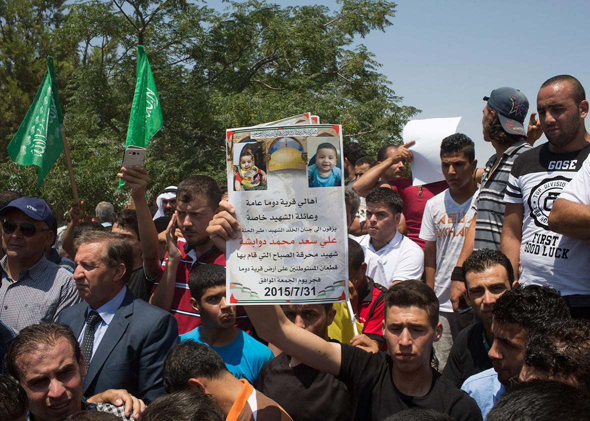 People gather in support of family members and relatives of 18-month-old Ali Dawabsheh as they hold his funeral on July 31, 2015, in the Palestinian village of Duma in the West Bank