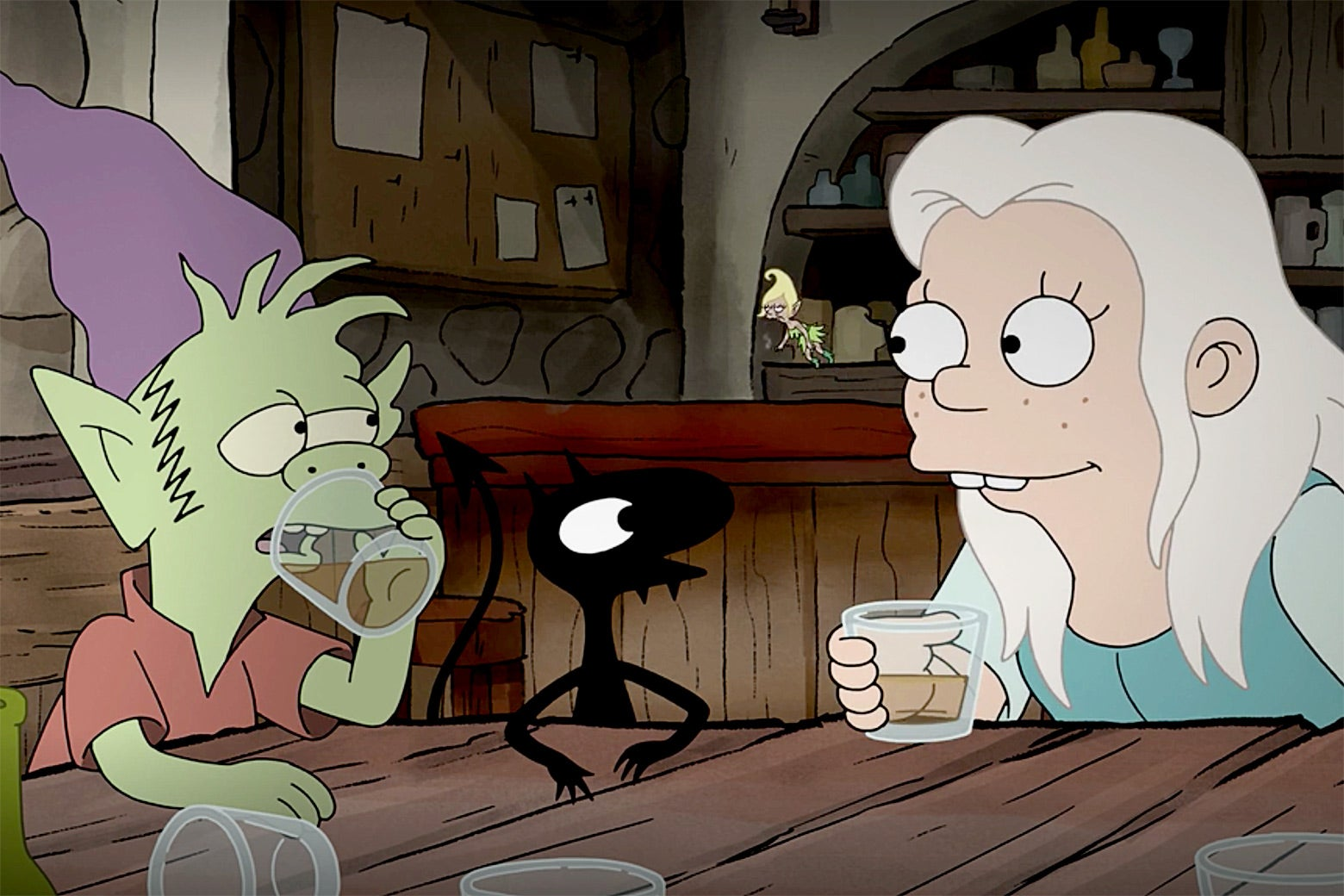 In a scene from Matt Groening's Disenchantment, Bean (Abbi Jacobson) shares a drink with her companions Elfo (Nat Faxon) and Luci (Eric André).