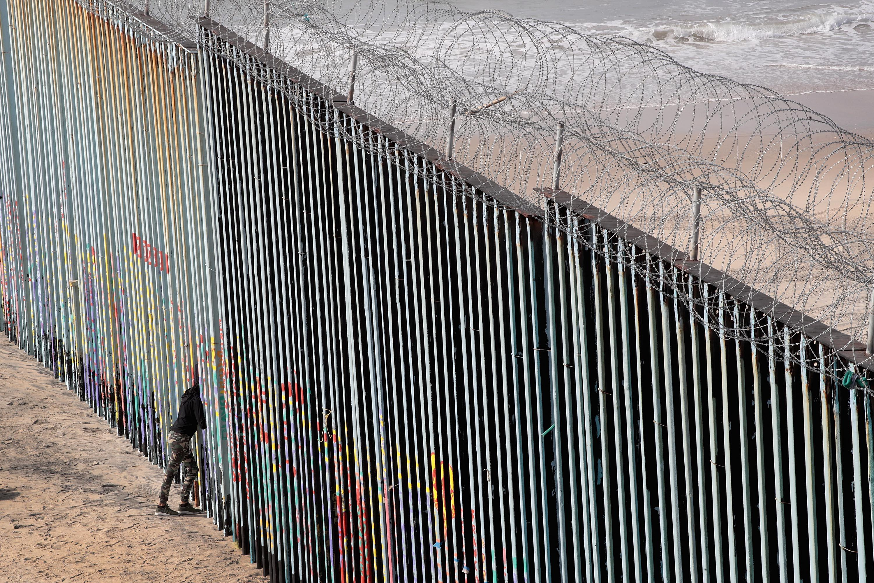 A woman looks through the border wall that separates the U.S. and Mexico on January 28, 2019 in Tijuana, Mexico.