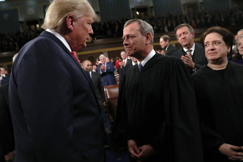 Trump stares down Roberts as Kagan looks on awkwardly.