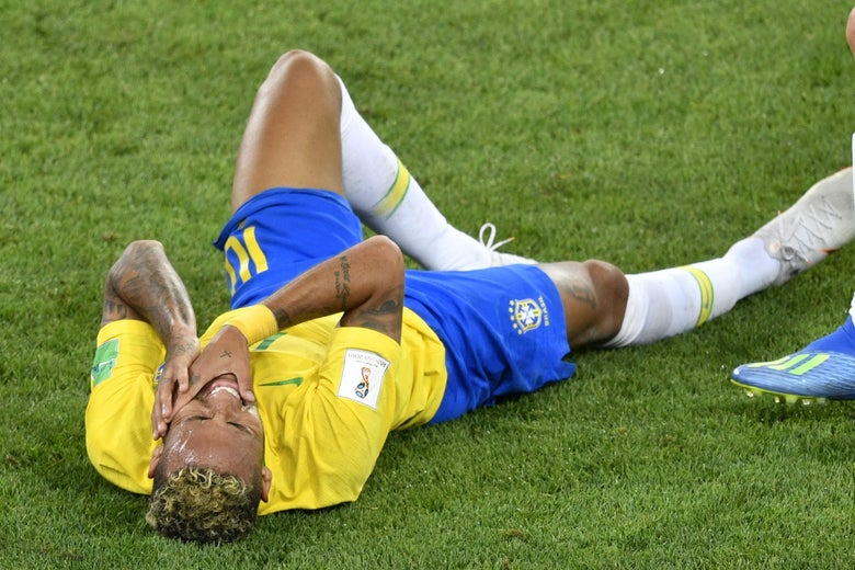 Brazil's forward Neymar lies on the ground during the Russia 2018 World Cup Group E football match between Serbia and Brazil at the Spartak Stadium in Moscow on June 27, 2018. (Photo by Alexander NEMENOV / AFP) / RESTRICTED TO EDITORIAL USE - NO MOBILE PUSH ALERTS/DOWNLOADS        (Photo credit should read ALEXANDER NEMENOV/AFP/Getty Images)