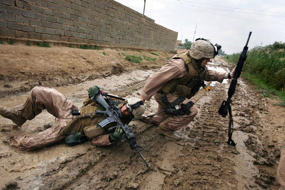 KARMAH, Iraq—Sgt. Jesse E. Leach drags Lance Cpl. Juan Valdez of Weapons Company, 2nd Battalion, 8th Marines, to safety moments after he was shot by a sniper during a patrol. Valdez was shot through the arm and right torso but survived, Oct. 31, 2006.