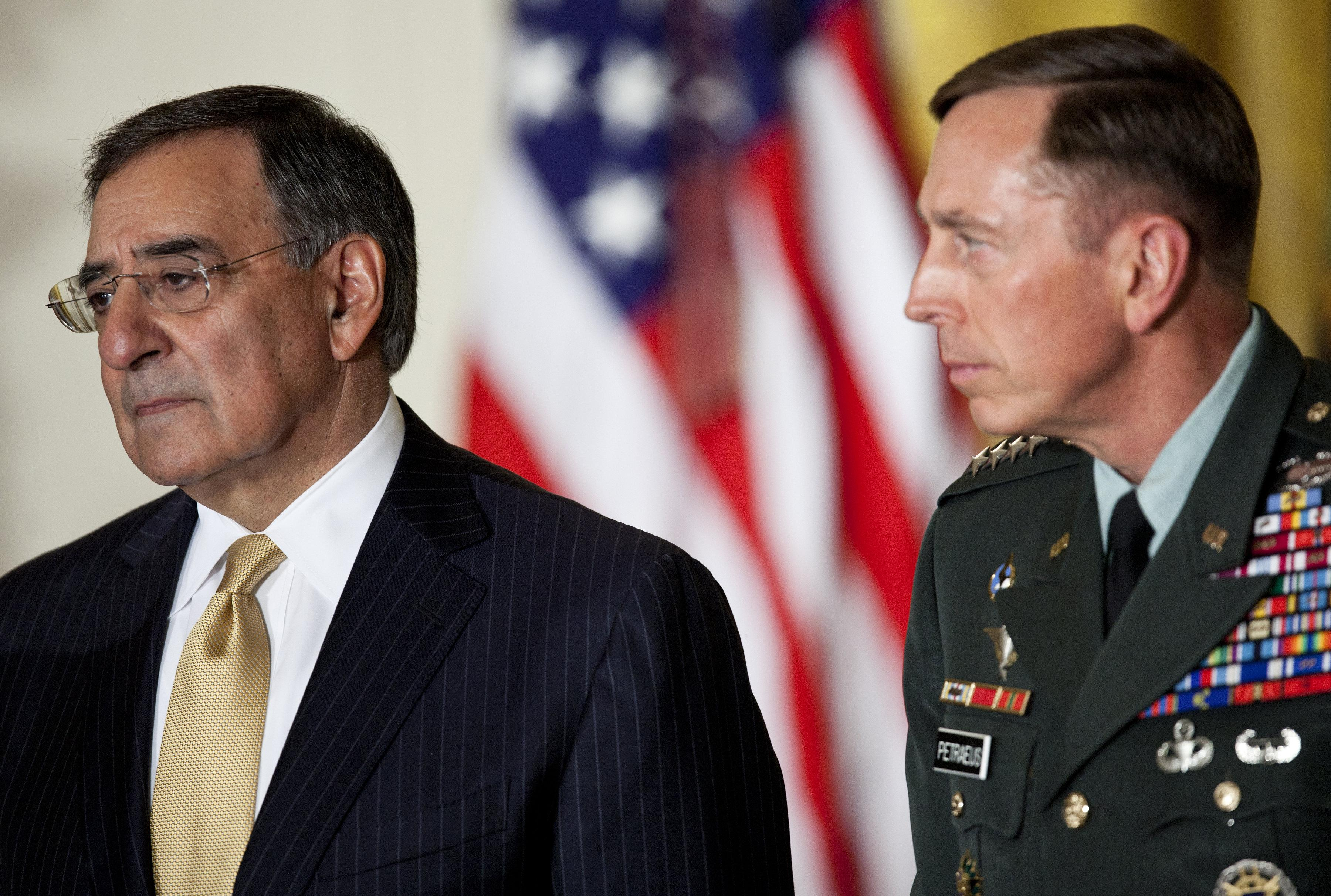 Then director of the Central Intelligence Agency Leon Panetta and Gen. David Petraeus listen during an event in the East Room of the White House.