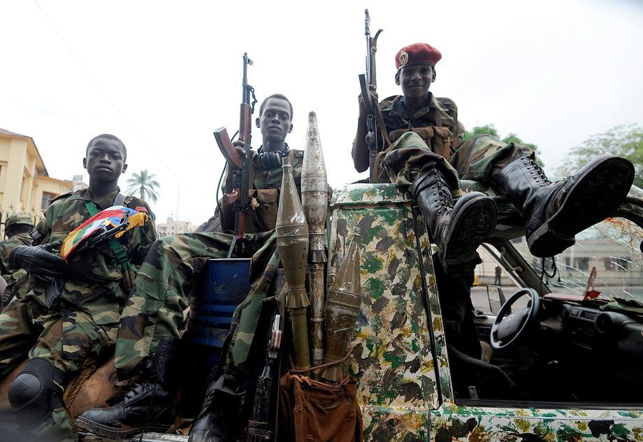 Child soldiers of the Seleka coalition sit on a pickup truck near the presidential palace in Bangui, Central African Republic, on March 25, 2013.