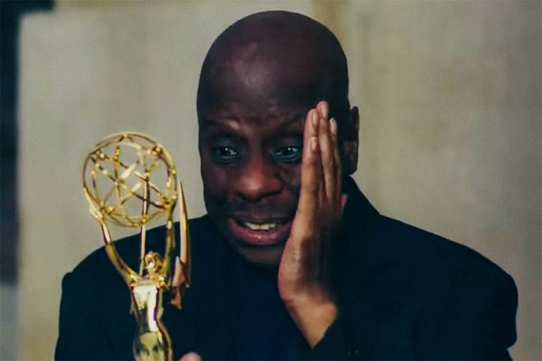Jimmie Walker, holding a Reparation Emmy.