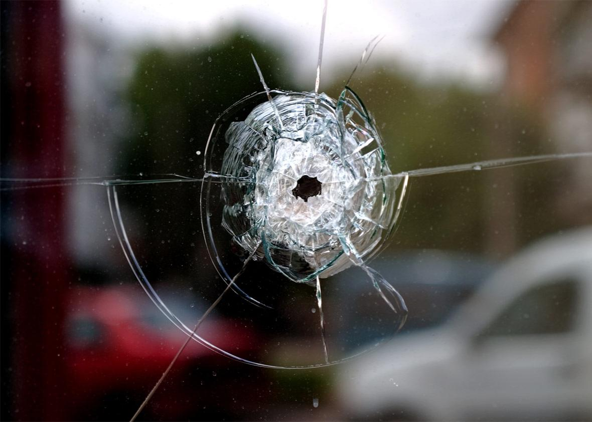 Bullet shot through window of home.