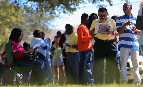 People wait in line to vote early on Wednesday in North Miami, Florida.