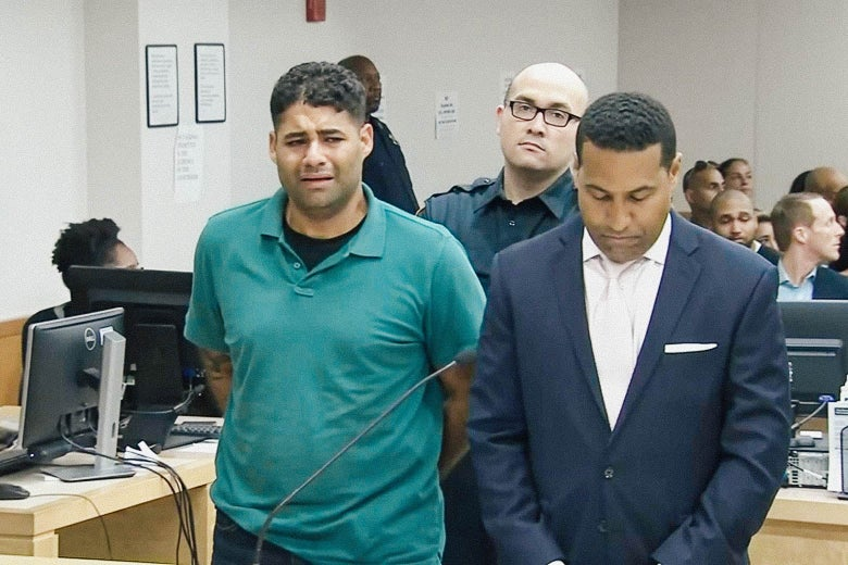 Juan Rodriguez looking anguished, standing with his arms behind his back in court.