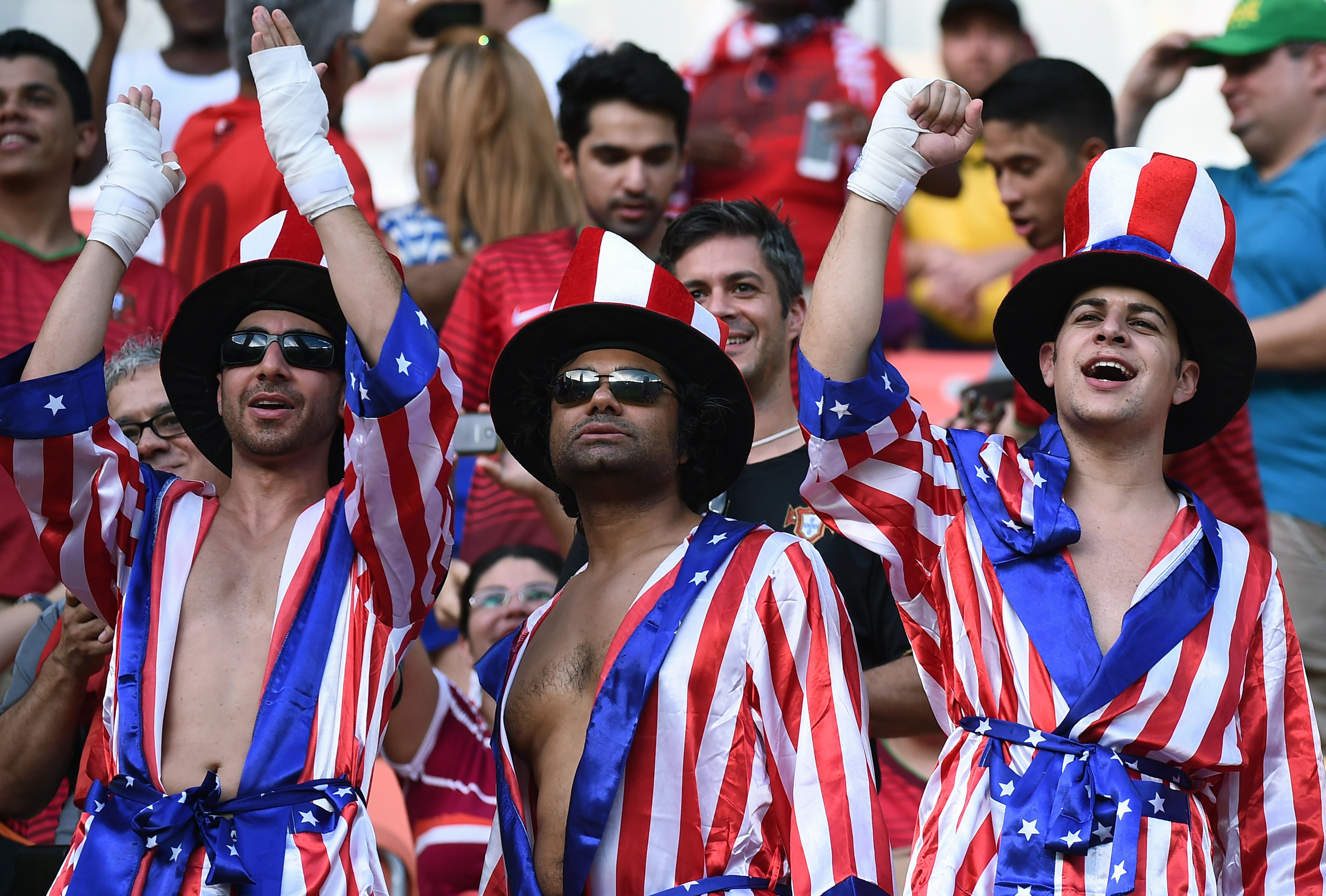 U.S. fans cheer before the start of the World Cup match between the U.S. and Portugal in Manaus, Brazil, on June 22, 2014.