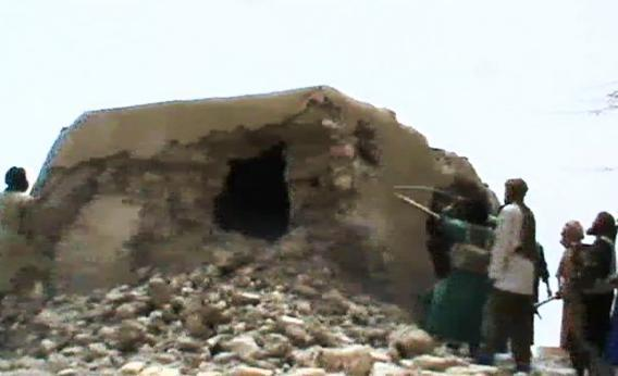 A still from a video shows Islamist militants destroying an ancient shrine in Timbuktu.