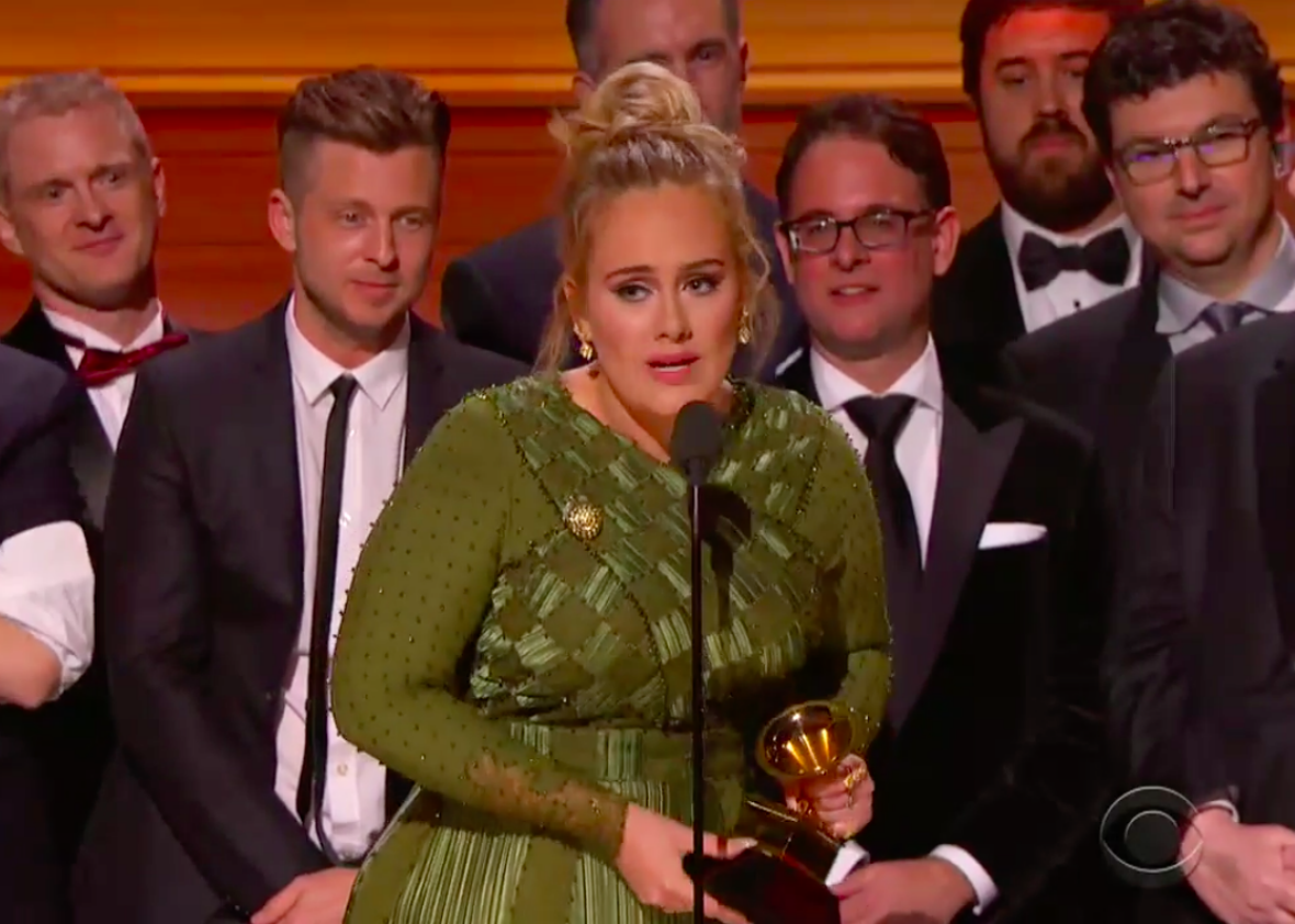 Adele accepts Album of the Year at the Grammys