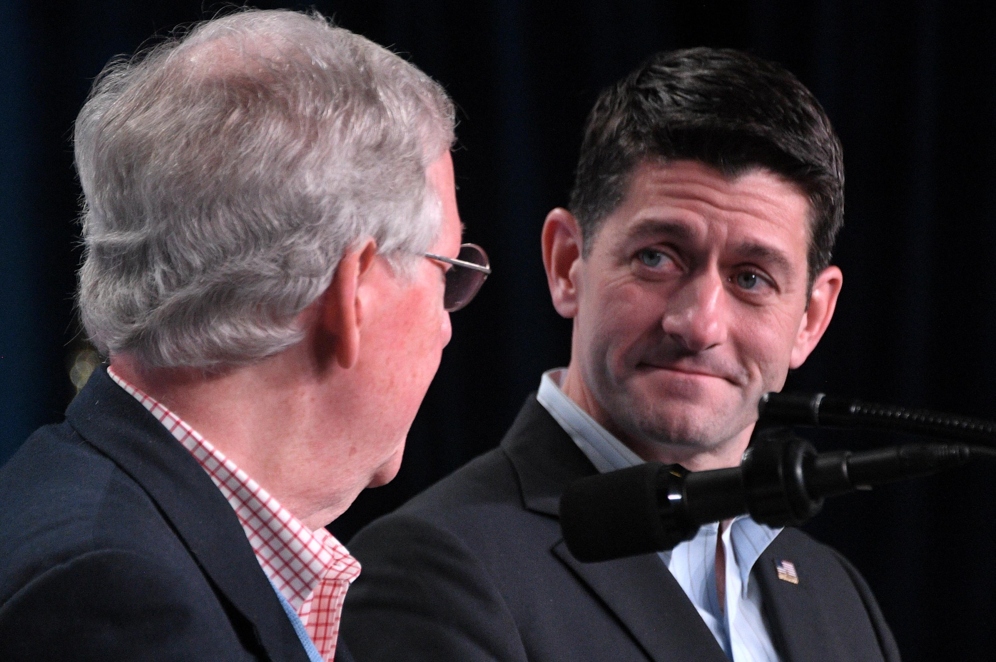 House Speaker Paul Ryan (R) and Senate majority leader Mitch McConnell (L) deliver a speech in White Sulphur Springs, West Viriginia during the Republican party retreat on February 01, 20108.          / AFP PHOTO / JIM WATSON        (Photo credit should read JIM WATSON/AFP/Getty Images)