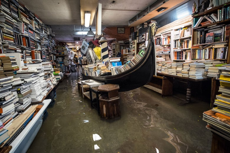 Water inside the historic Venice bookshop 'Libreria Acqua Alta'.