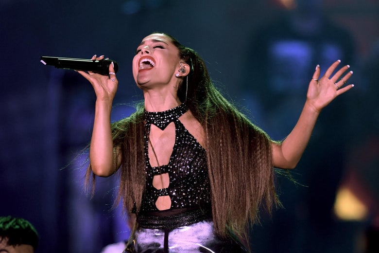Ariana Grande singing.