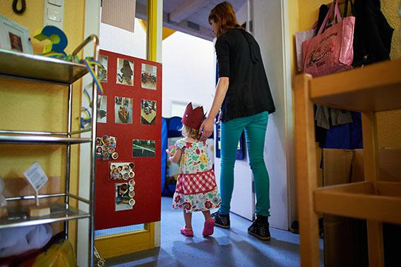 A Kindergarten teacher accompanies Mathilda, who celebrates her third birthday, in a Kindergarten on July 11, 2013 in Pfungstadt, Germany.
